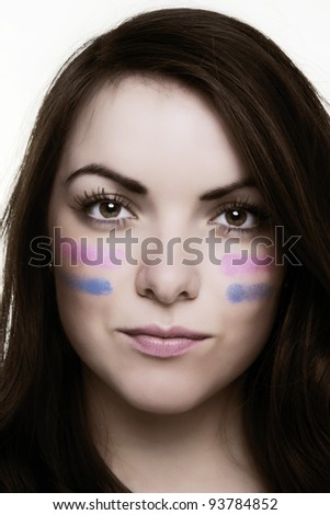 woman putting lines under her eyes as if ready for war like.