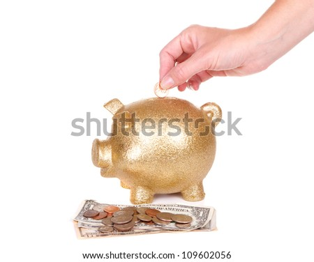 woman putting money in piggy bank, on white