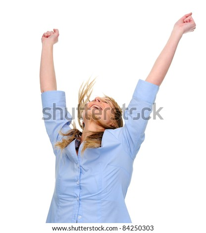 Woman raises her arms overhead in joy
