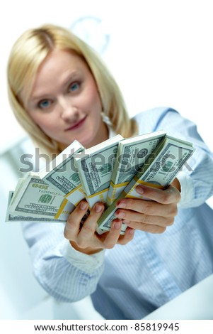 Woman reaching out dollar rolls