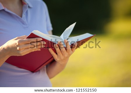woman reading a book (summer day, foreground focus)