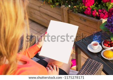 Woman reading blank sample page, empty template for your own design. #1175278171