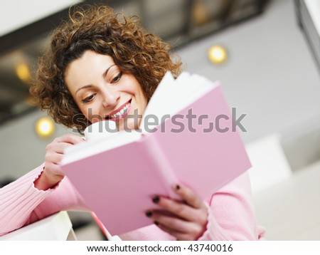 woman reading book at home and drinking coffee. Copy space