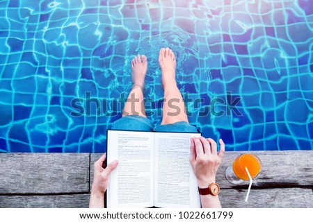 Woman Reading Book at the Swimming Pool Side, Relaxing with Summer Drink in her Vacation, Top View #1022661799