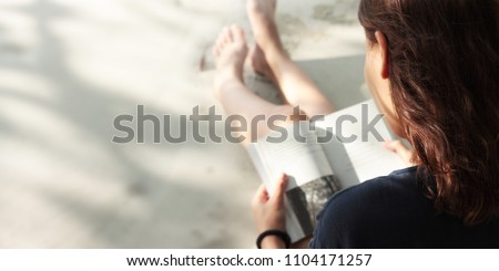 Woman reading book on the Beach #1104171257