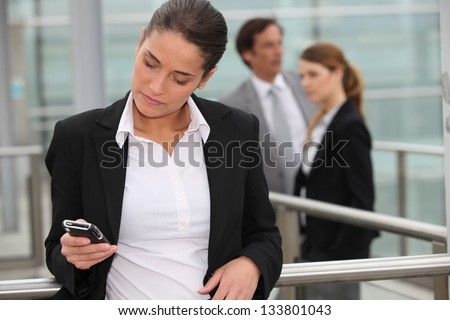 Woman reading message on mobile