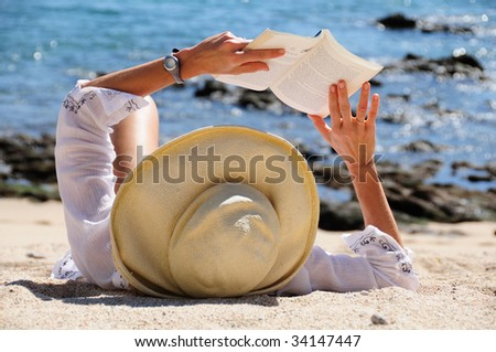 Woman Reading On Beach - stock photo
