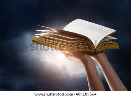 woman reading the bible in the darkness #409189564