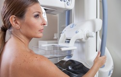 Woman ready to undergo mammography scan.