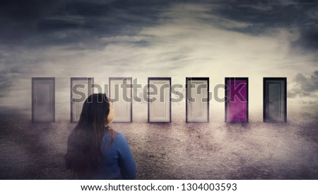 Woman rear view in front of many doors choosing one different colored. Difficult decision, important choice concept, failure or success. Ways to unknown future, business career development opportunity #1304003593