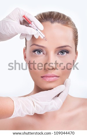 Woman receiving botox injection in the eyebrow zone
