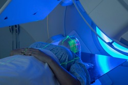 Woman receiving Radiation Therapy for Cancer Treatment