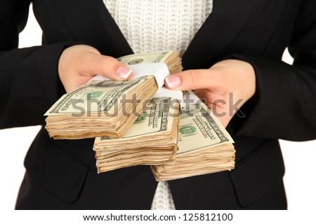 Woman recounts dollars, close up