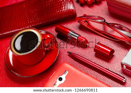 Woman red accessories with coffee, cosmetic, jewelry, gadget and other luxury objects on leather background, fashion industry, modern female concept, selective focus  stock photo