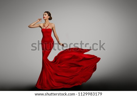 Woman Red Dress, Fashion Model in Long Silk Sexy Gown, Waving Flying Fabric Tail Train, Cloth Fluttering on Wind #1129983179