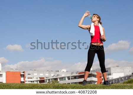 woman refreshing after her city outdoor exercise
