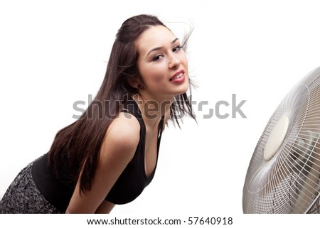 Woman refreshing in front of big cooler