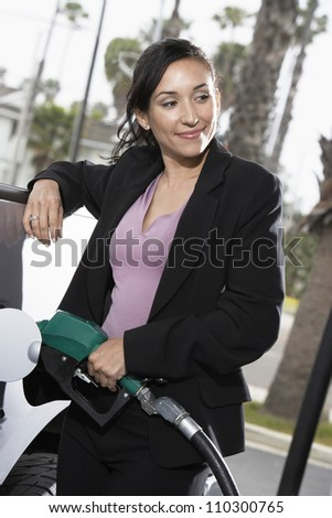 Woman refueling her car