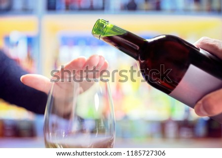 Woman refusing more alcohol from wine bottle in bar Foto stock ©