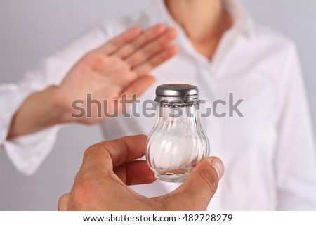 Woman refusing salt. Health care concept, hypertension prevention Stock photo ©