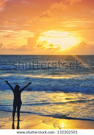 woman rejoice in the sunset at the beach. vitality of the concept of healthy living holidays