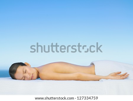 Woman relaxing and sunbathing in spa