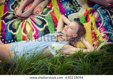 Woman relaxing at campsite on a sunny day #630218096