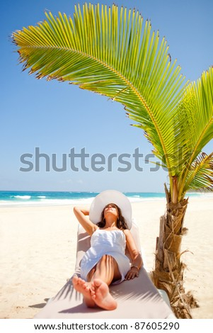 Woman relaxing at the beach enjoying her vacations