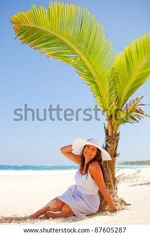 Woman relaxing at the beach looking very happy