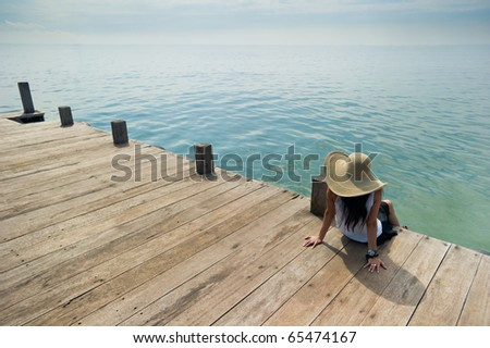 woman relaxing at the dock