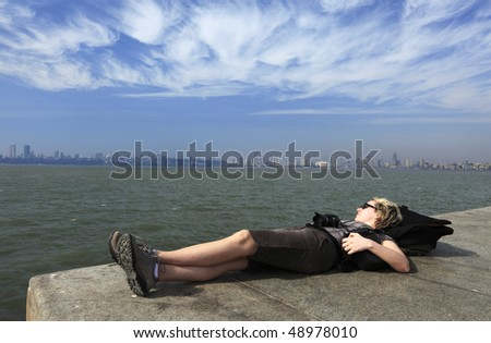 "woman relaxing at the ""marine drive"" in Mumbai ( Bombay),India-