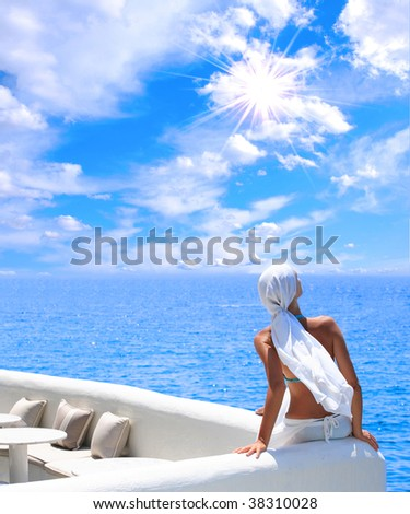 woman relaxing in the afternoon by the sea - Shutterstock ID 38310028