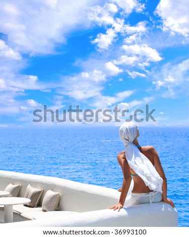 woman relaxing in the afternoon by the sea in Santorini Greece - Shutterstock ID 36993100