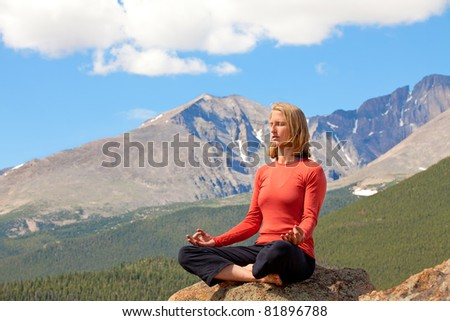 Woman relaxing in the mountains