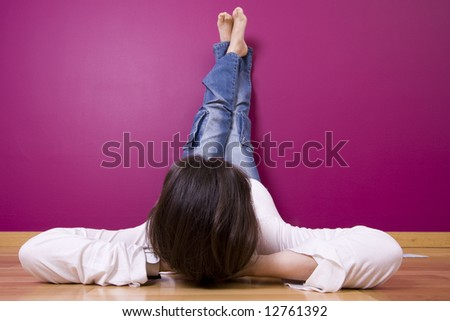 woman relaxing, looking a t her new painted wall (focus on the head)