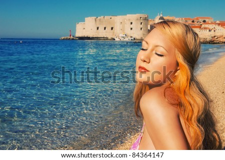 Woman relaxing on a beach in Dubrovnik