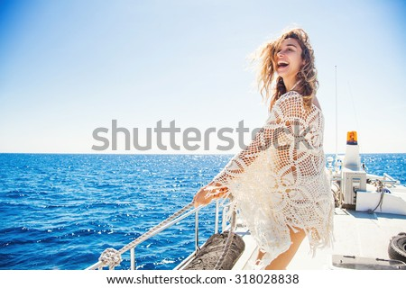 woman relaxing on a cruise boat wearing knitted dress