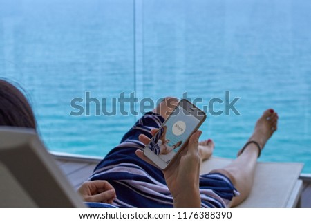 woman relaxing on a deck chair sharing a photo