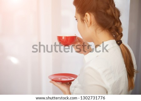 Woman Relaxing On Balcony Holding Cup Of Coffee Or Tea Stock Photo