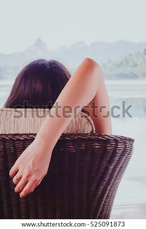 Woman relaxing on beach, ocean view with concept the Award of life with stay and relax the mind. #525091873