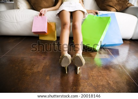 Woman relaxing on couch after long day shopping