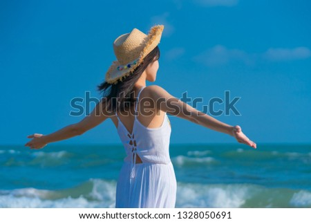 Woman relaxing on the beach. Woman relaxing on the beach. .Vacation lifestyle. #1328050691