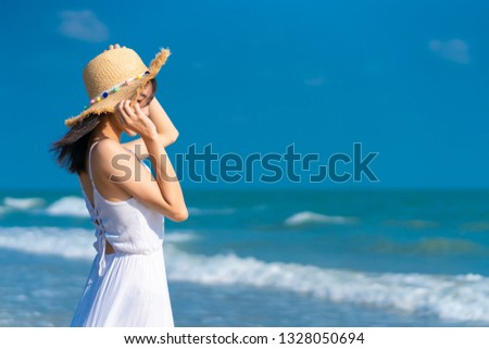 Woman relaxing on the beach. Woman relaxing on the beach. .Vacation lifestyle. #1328050694