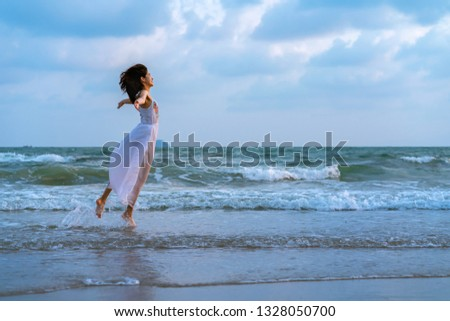 Woman relaxing on the beach. Woman relaxing on the beach. .Vacation lifestyle. #1328050700