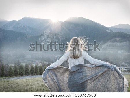 Woman relaxing outdoors mountain view. Lifestyle