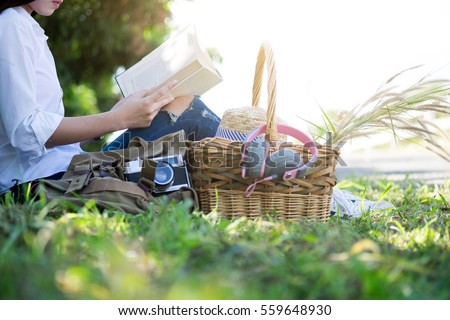 Woman relaxing picnic in the park and reading a book. Hobby freetime and leisure time.  #559648930