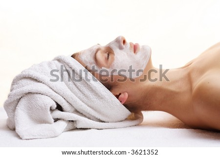 Woman relaxing with beauty mask.