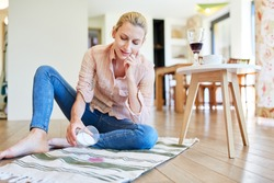 Woman removes red wine patches on the carpet with salt as a home remedy