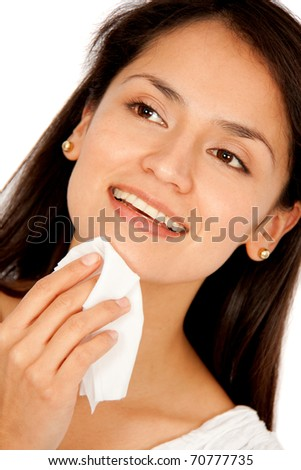 Woman removing her make-up with cleansing wipes ? isolated