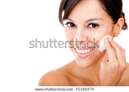 Woman removing make up with a cream and cotton - isolated